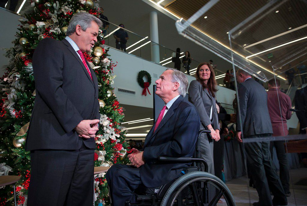 Austin Mayor Steve Adler (left, with Gov. Greg Abbott at Apple's announcement of a new campus) has questioned the city's previous issuance of 18,000 citations to homeless people over three years as an unproductive approach that criminalizes homelessness.