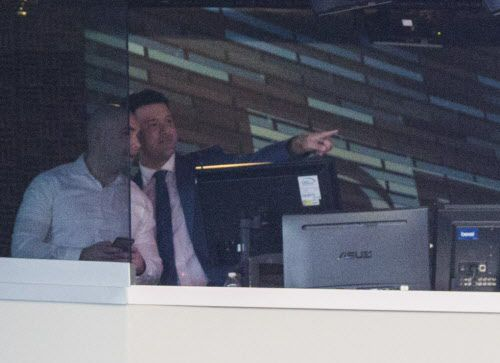 """Broadcaster and former Dallas Cowboys quarterback Tony Romo points to a sign in the stadium that says """"Welcome Back 9"""" from the broadcast booth before an NFL game between the Dallas Cowboys and the Kansas City Chiefs on Sunday, November 5, 2017 at AT&T Stadium in Arlington, Texas. (Ashley Landis/The Dallas Morning News)"""