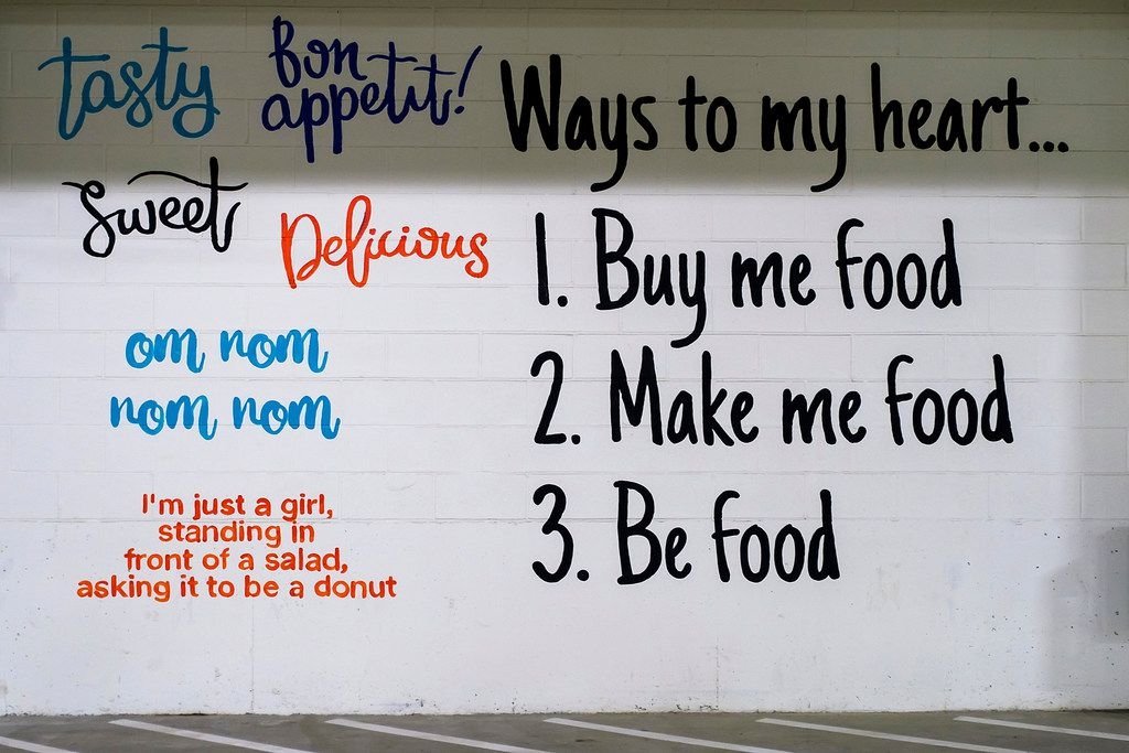 Slogans painted in the parking lot of the new Tom Thumb at the Union. This  is across from the curbside pick-up area where shoppers driving to the store receive their online grocery purchases.  (Smiley N. Pool/The Dallas Morning News)