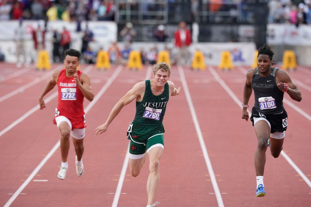 Houston Strake Jesuit's Matthew Boling (center) powers his way to the finish line to win the Class 6A boys 100-meter dash at the UIL state track meet with a time of 10.13 seconds Saturday. (Bob Daemmrich/Special Contributor)