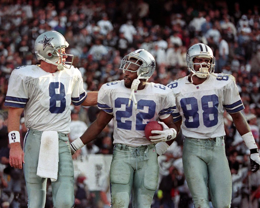 1995 - Dallas Cowboys (L-R) Troy Aikman, Emmitt Smith and Michael Irvin celebrate after Smith scored.  (Louis DeLuca/The Dallas Morning News)