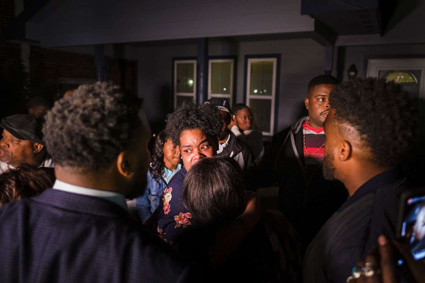 Members of the victimÕs family gather in the front yard of the house where Atatiana Jefferson was shot and killed  during a community vigil for Jefferson  on Sunday, Oct. 13, 2019, in Fort Worth.