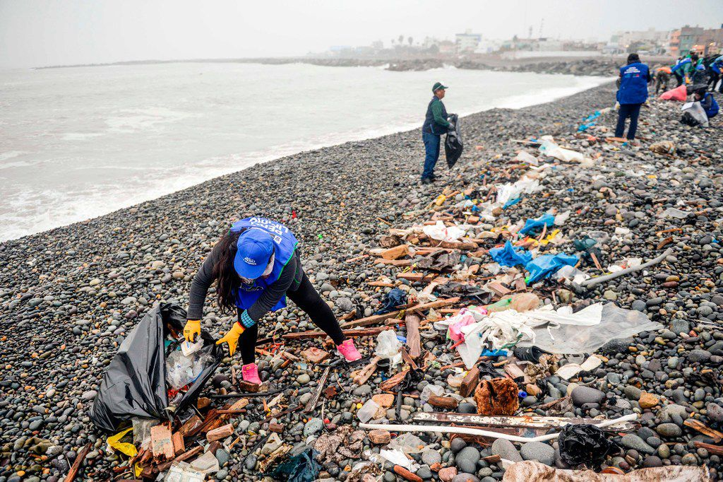 Volunteers clean up plastic waste on a beach in Lima, during the World Environment Day on June 5, 2018. The U.N. urged taking steps against the use of plastic bags, as part of a global challenge to reduce the increasing pollution of the oceans.