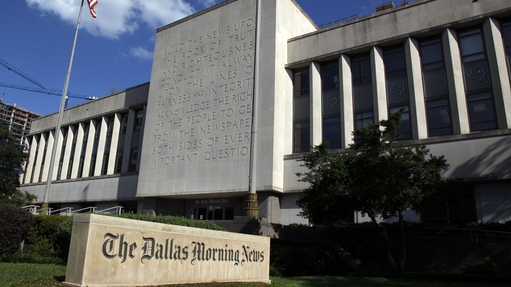 The Dallas Morning News building on Young Street is selling to KDC and Hoque Global.