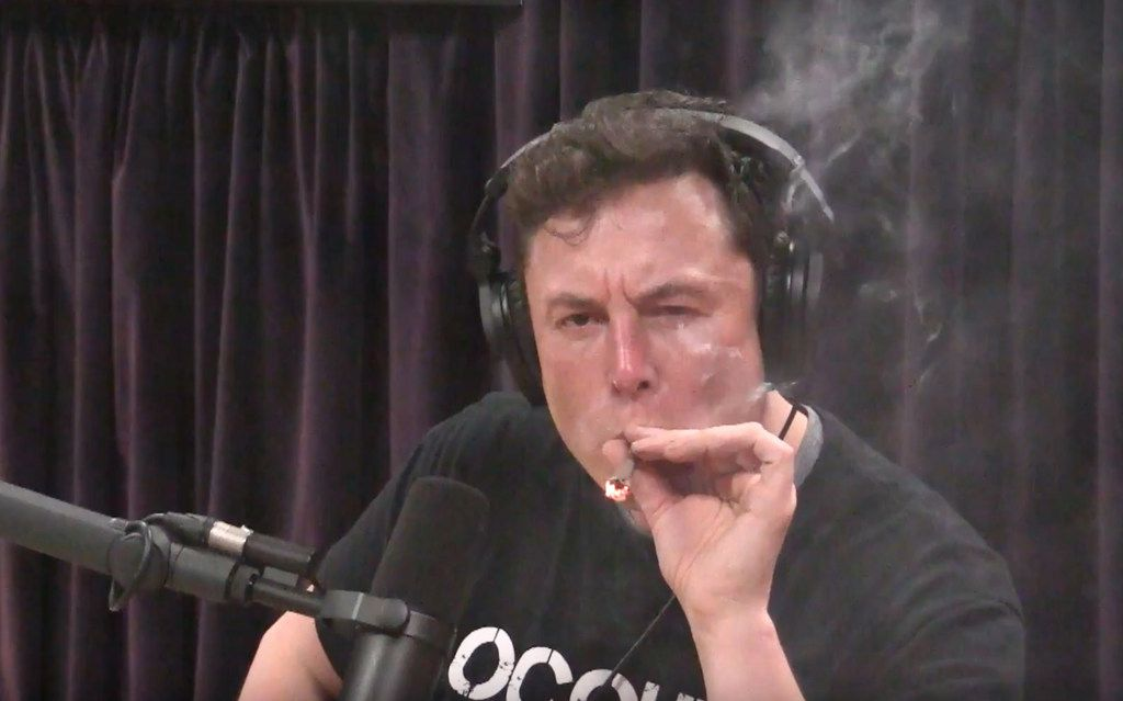 Elon Musk, chairman and CEO at Tesla and chairman of SpaceX, inhales what he said was marijuana on a live YouTube webcast Thursday night.