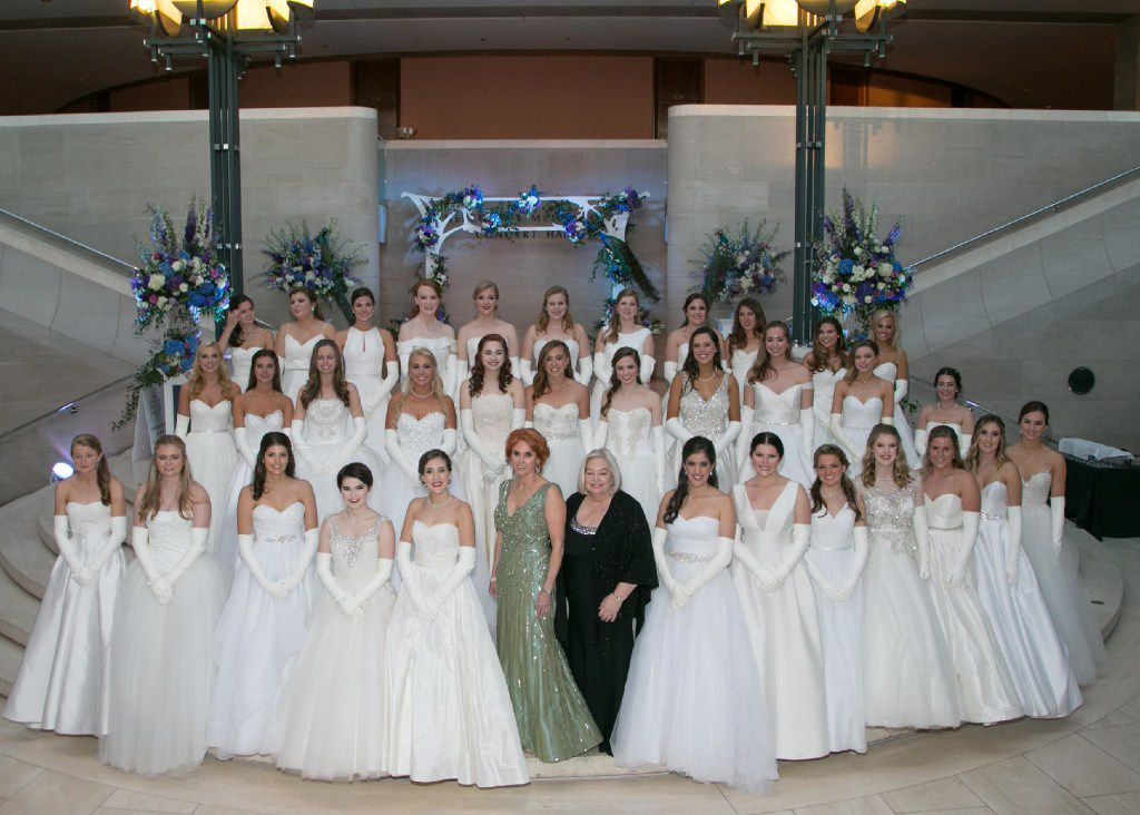 Ball chair Jolie Humphrey (foreground In green), and Sandy Secor (foreground in black), president of the Dallas Symphony Orchestra League, are shown with this year's 35 debutantes.