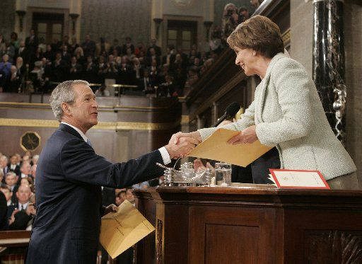 US President George W. Bush greets Speaker of the House Nancy Pelosi during the 2007 State of the Union address.