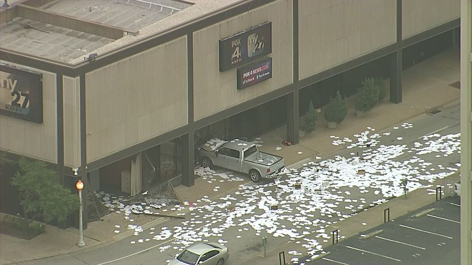 Papers lie scattered after a truck rammed into the Fox4 news studio Wednesday morning in downtown Dallas.