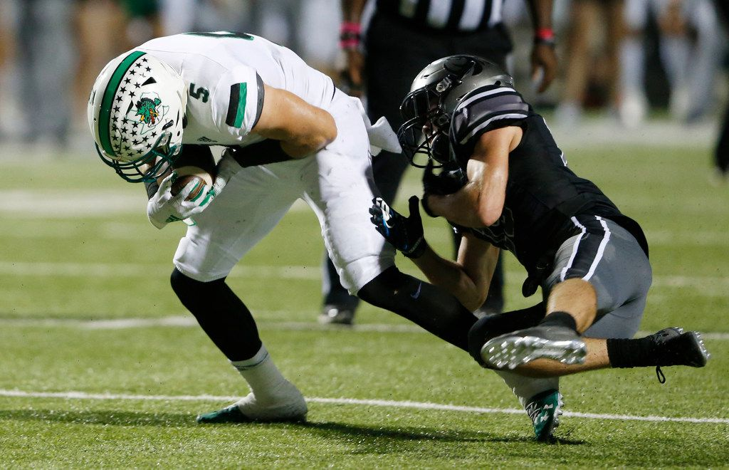 Southlake Carroll's Wills Meyer (5) breaks away from  Denton Guyer's Seth Meador (19) for a touchdown during the first half of play at C.H. Collins Complex in Denton, on Friday, October 4, 2019. (Vernon Bryant/The Dallas Morning News)