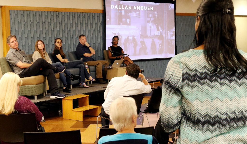 Sarah Davenport, right, of Mesquite, thanks The Dallas Morning News photojournalists Tom Fox, left, Rose Baca, Ashley Landis, Smiley Pool and director of photography Marcia Allert after a panel discussion about the July 7th ambush at J. Erik Jonsson Central Library, on Thursday evening, July 6, 2017, in Dallas Texas.