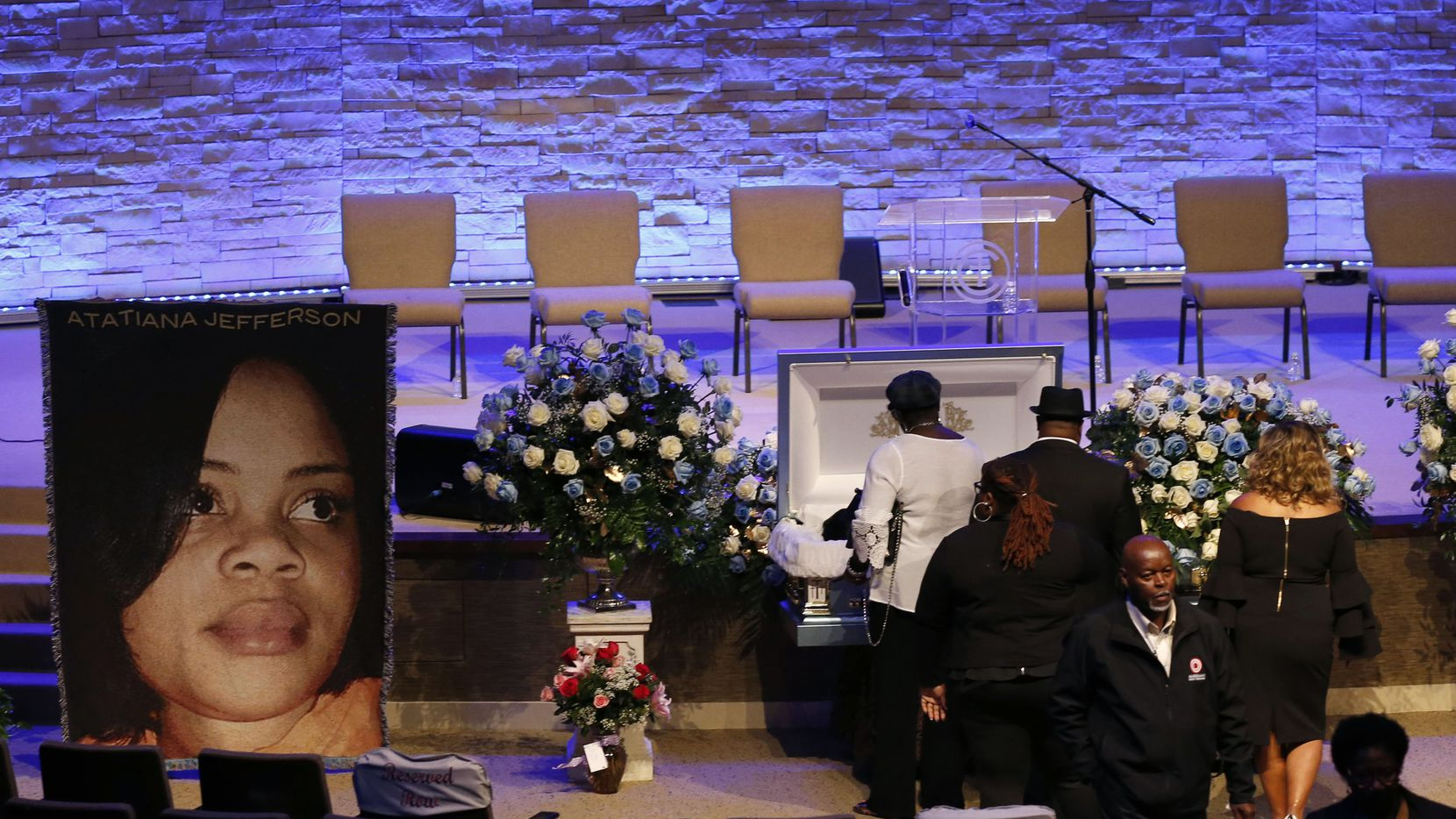 People mourn the loss of Atatiana Jefferson before the start of her funeral at Concord Church in Dallas on Oct. 24, 2019. Jefferson, 28, was fatally shot by a former Fort Worth officer Aaron Dean on Oct. 12.