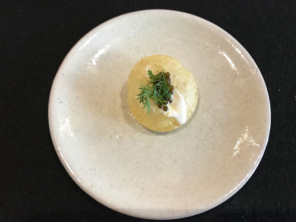 """. . . and a tiny """"infladito"""" – a puffed corn tortilla with caviar, crème fraîche and dill. (Leslie Brenner/Staff)"""
