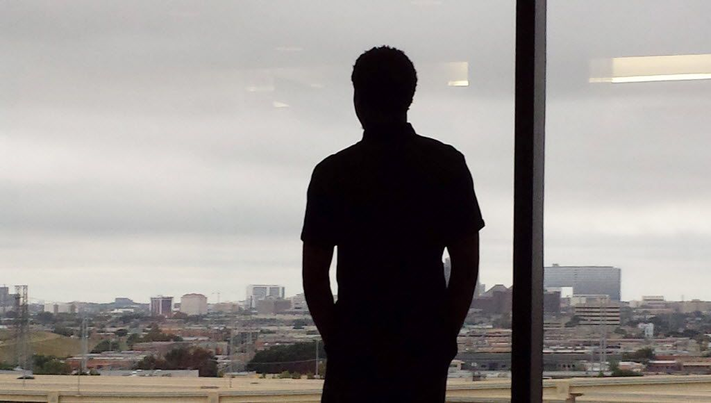 Johnson peers at the Dallas skyline at a court appearance in August 2014, a year before he was arrested on a murder charge. (Stephenson family)