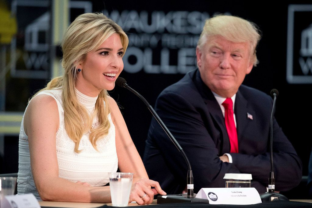 President Donald Trump listens as his daughter Ivanka Trump speaks at a workforce development roundtable at Waukesha County Technical College in Pewaukee, Wis., in June.