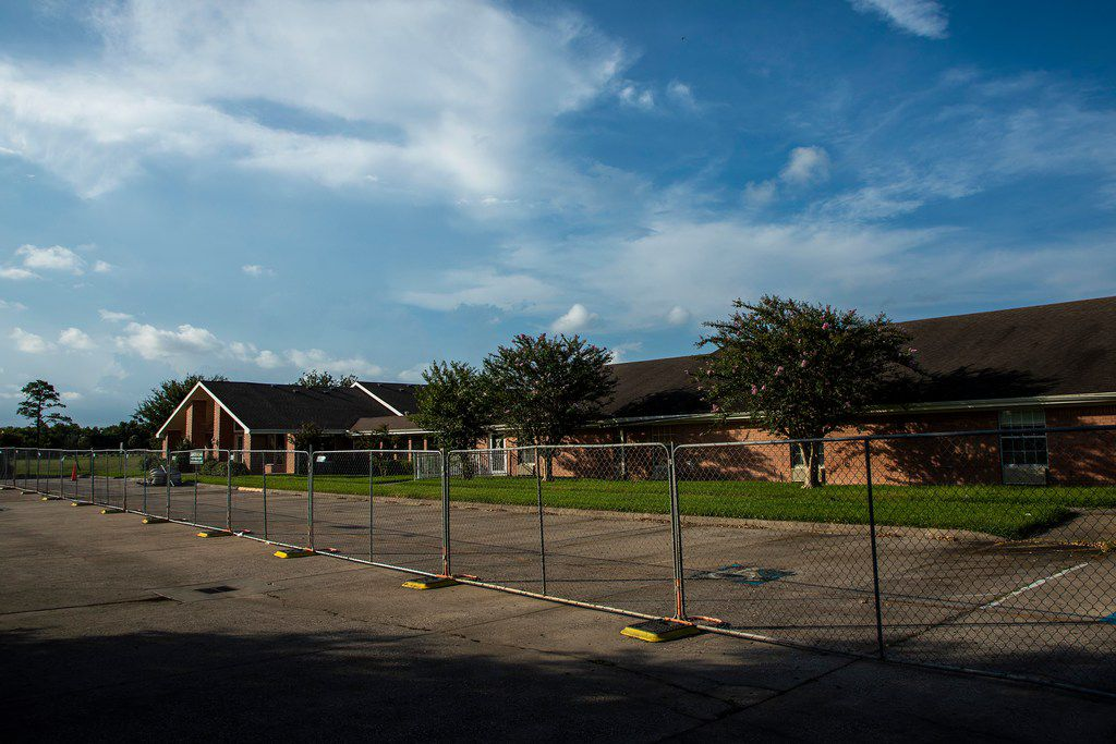 A fence surrounds the vacant Cypress Glen nursing home on Monday in Port Arthur.  The Texas Health and Human Services Commission closed its investigations into what happened at Cypress Glen and another facility owned by the same Dallas company without citing any violations when they couldn't reach the staff.  But this month, the commission unexpectedly reopened its investigation.  A criminal investigation into the refusal to evacuate residents is still pending.