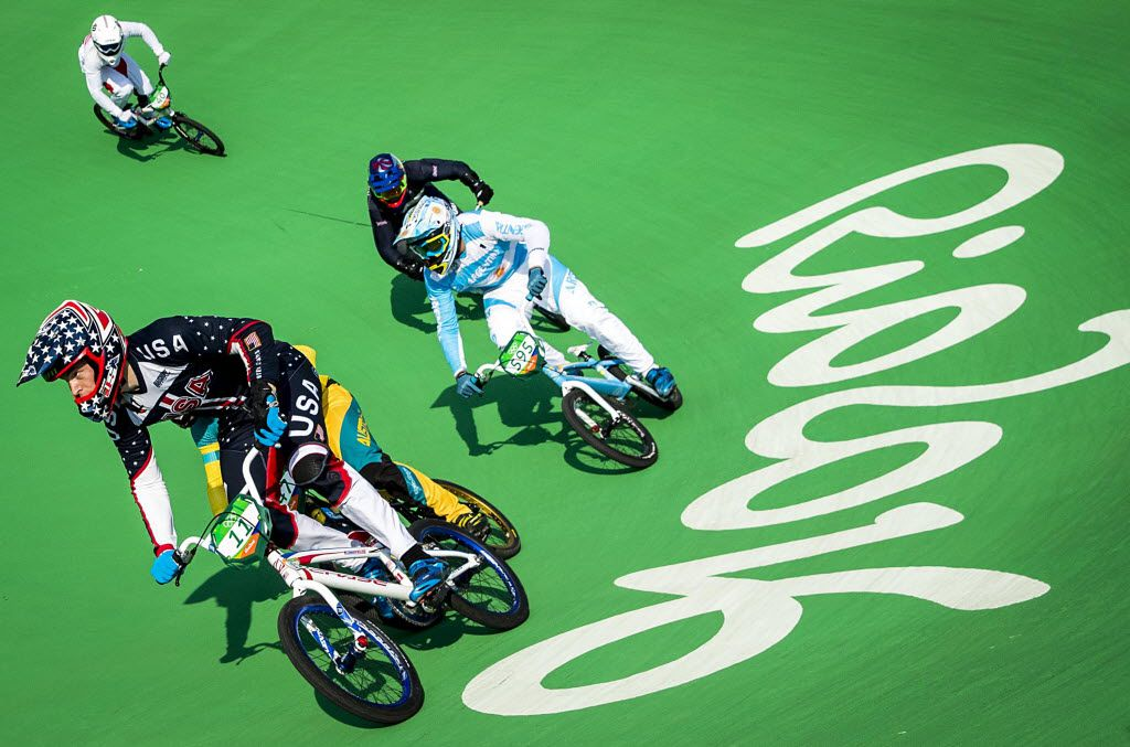 FILE - Connor Fields of the United States leads a racers around a turn during men's BMX quarterfinals at the Rio 2016 Olympic Games on Thursday, Aug. 18, 2016, in Rio de Janeiro. (Smiley N. Pool/The Dallas Morning News)