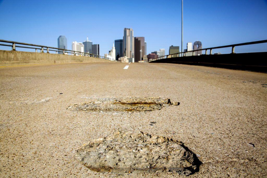 A pothole leading into downtown Dallas.