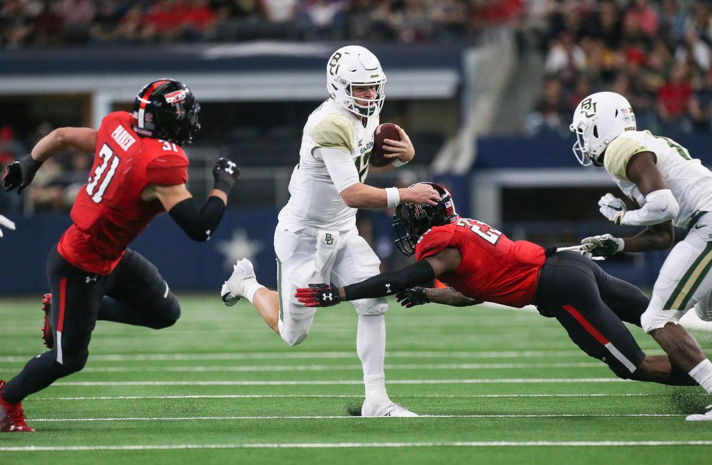 Baylor Bears quarterback Charlie Brewer (12) makes a break with the ball during the second half of a matchup between Baylor and Texas Tech on Saturday, Nov. 24, 2018 at AT&T Stadium in Arlington, Texas.