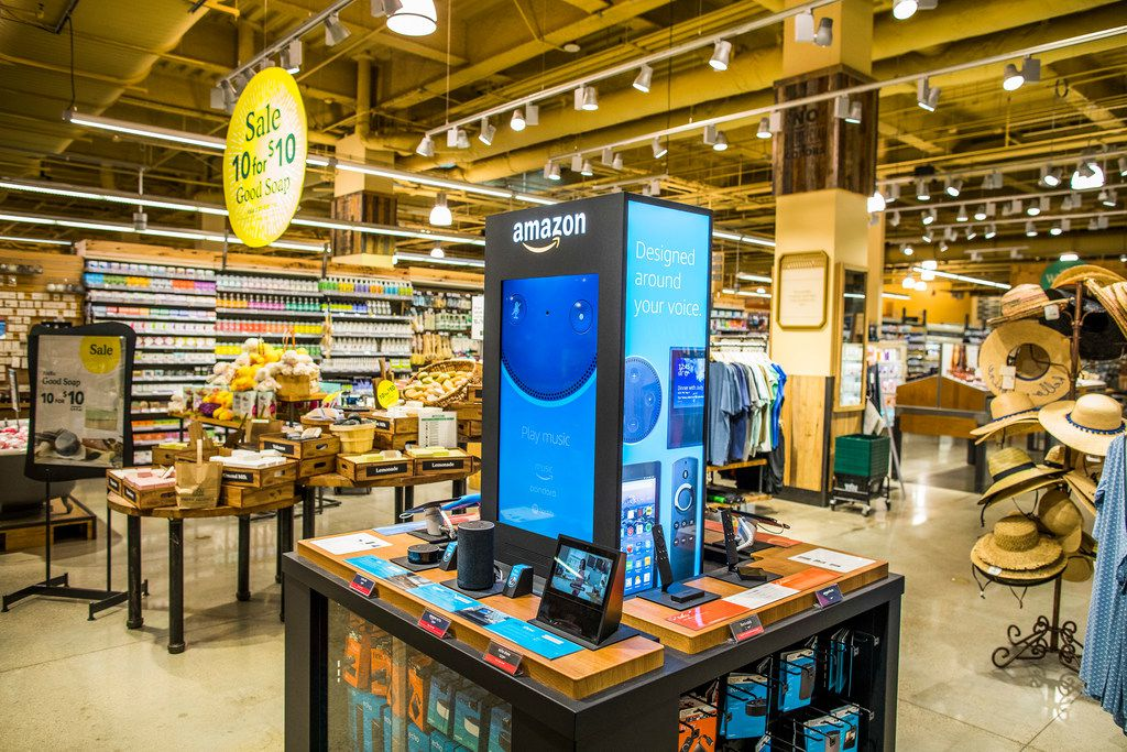 Amazon products on display inside Whole Foods' flagship store in Austin, Texas, Feb. 23, 2018. Whole Foods customers who are also Amazon Prime members will get 10 percent off hundreds of sale items in stores, including tilapia, organic baby kale and chicken breasts, the company announced on May 16.