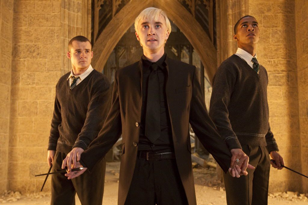 "In this film publicity image released by Warner Bros. Pictures, from left, Josh Herdman portrays Gregory Goyle, Tom Felton portrays Draco Malfoy and Louis Cordice portrays Blaise Zabini in a scene from ""Harry Potter and the Deathly Hallows: Part 2."""