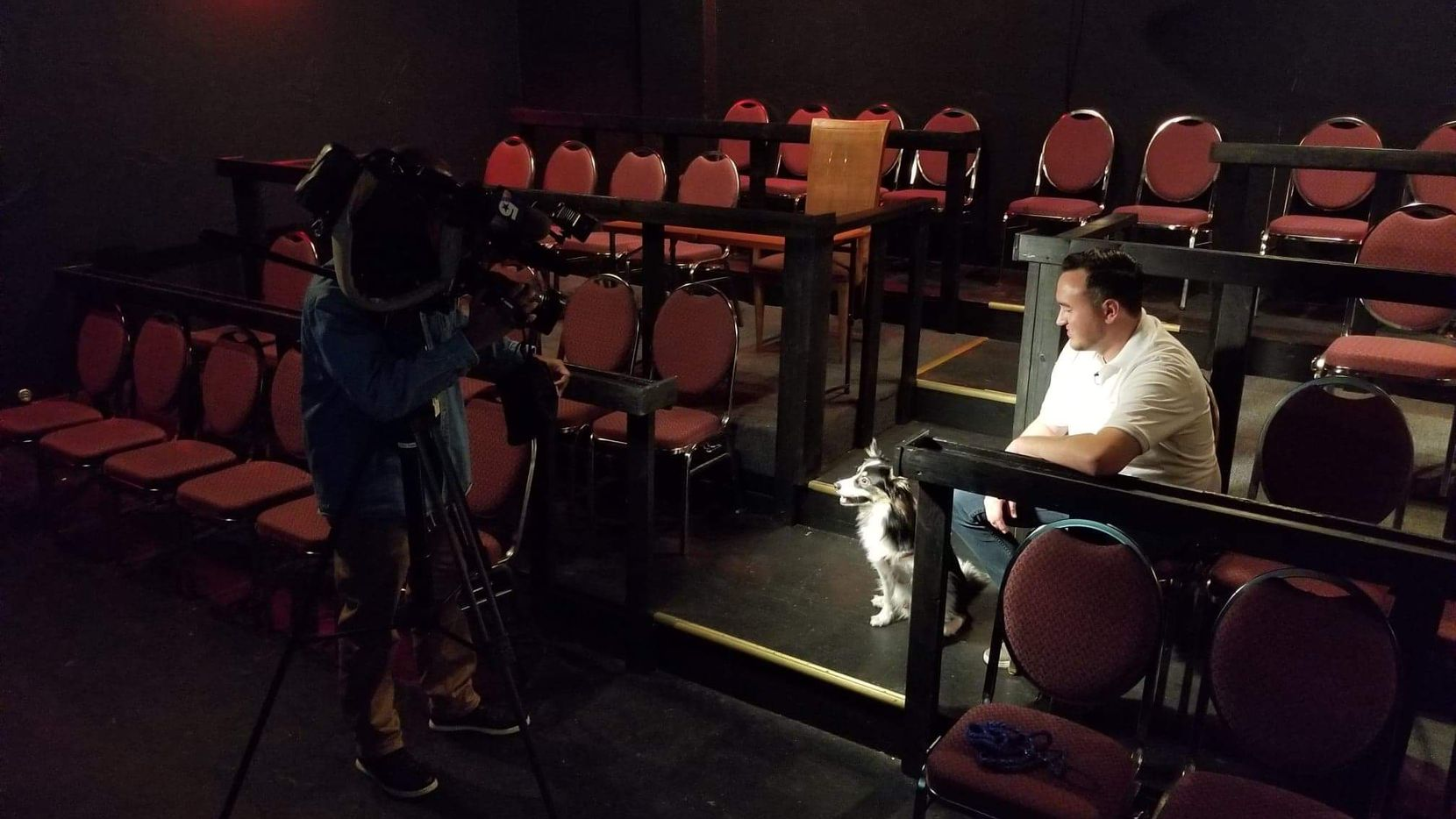 K9 Cinemas founder Eric Lankford and his dog, Bear, inside the dog-friendly movie theater. It was recently featured on NBC5.