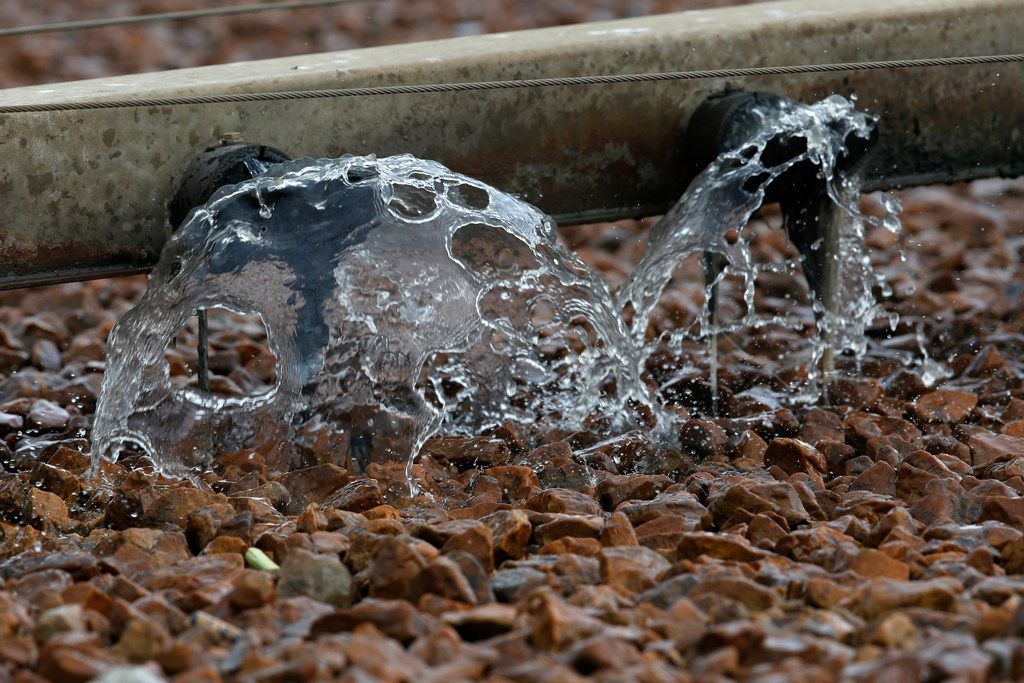 Water is pumped onto rocks of trickling filter that are used as a part of the wastewater treatment process to decompose organic material in wasterwater at Central Wastewater Treatment Plant in Dallas on Feb. 16, 2018.  (Nathan Hunsinger/The Dallas Morning News)