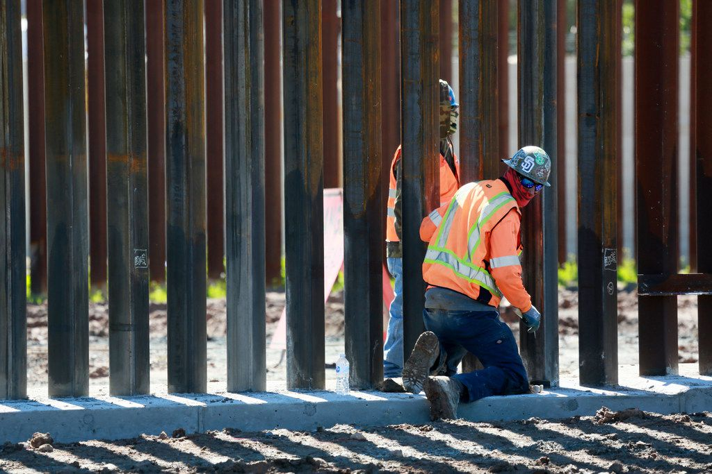 OTAY MESA, CA - FEBRUARY 22: Construction workers build a secondary border wall on February 22, 2019 in Otay Mesa, California.  The Department of Homeland Security is building 12.5 miles of secondary border wall as part of Presient Donald Trump's Border Security and Immigration Enforcement Improvements Executive Order to build new fencing along the Southern Border.  (Photo by Sandy Huffaker/Getty Images)