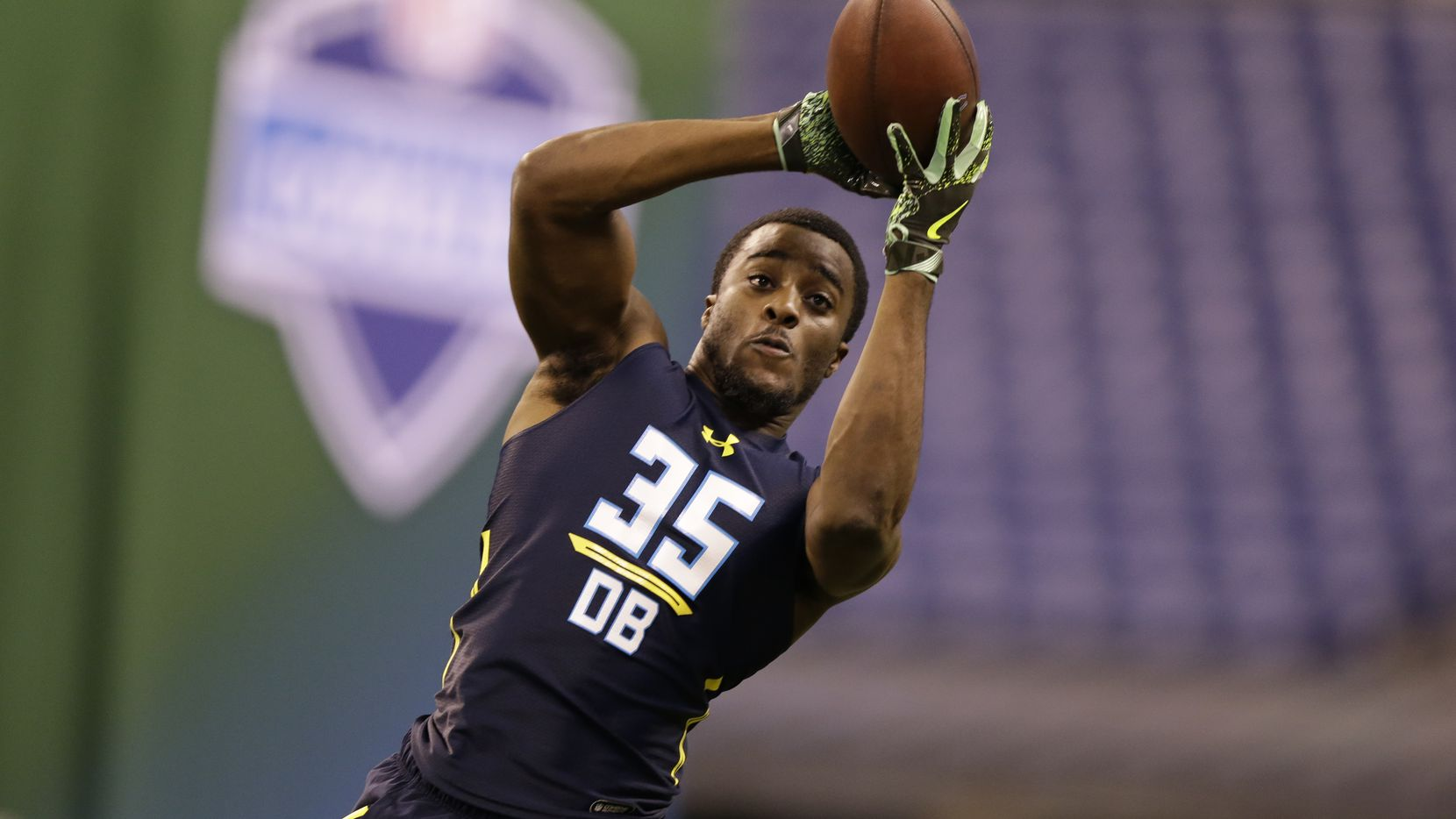 Michigan defensive back and Cowboys third-round pick Jourdan Lewis runs a drill at the NFL football scouting combine in Indianapolis March 6.