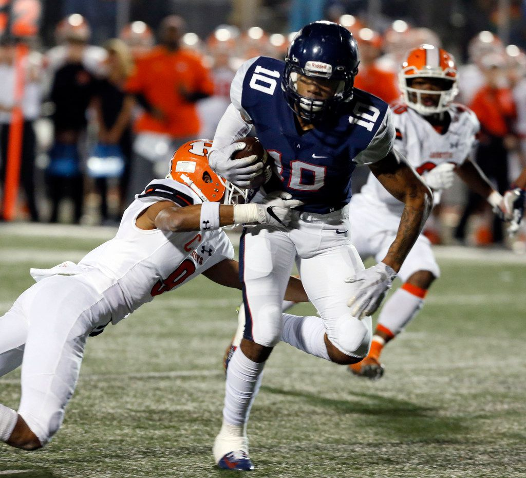 Allen's Theo Wease (10) twists free of a Rockwall defender Elijah Coleman (9) and heads to the end zone for the team's final touchdown during the fourth quarter of the Class 6A Division I Region II area-round football playoff game against Rockwall at Williams Stadium in Garland on Friday, November 23, 2018. Allen won the game 52-40. (John F. Rhodes / Special Contributor)