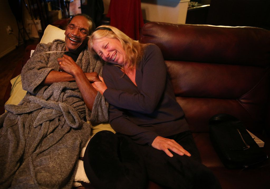 Johnnie Lindsey, a Texas exoneree who spent 26 years in prison for a crime he didn't commit, laughs with Dorothy Budd, author of Tested: How Twelve Wrongly Imprisoned Men Held Onto Hope, at his home in Dallas on Jan. 24, 2018. Lindsey is in hospice at his home for liver cancer and is one of the men featured in the book.