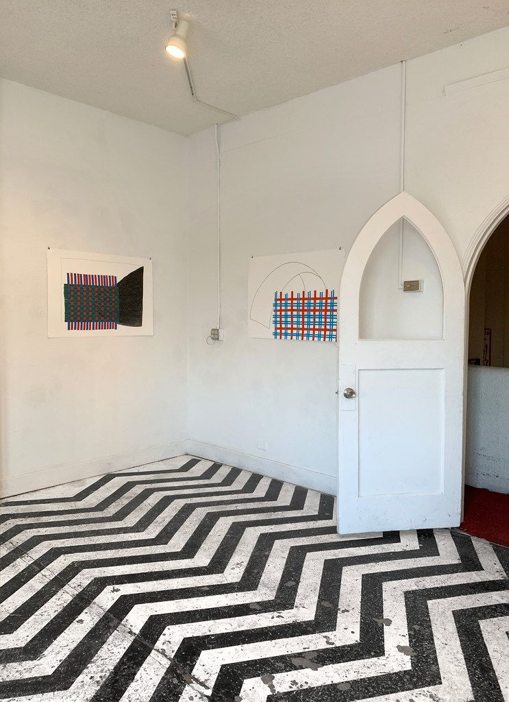 """Interior detail with two works by Alicja Bielawska from the series, Patterns, 2013, pencil, collage on paper at the exhibition """"In Memory"""" at Cydonia gallery in Oak Cliff."""