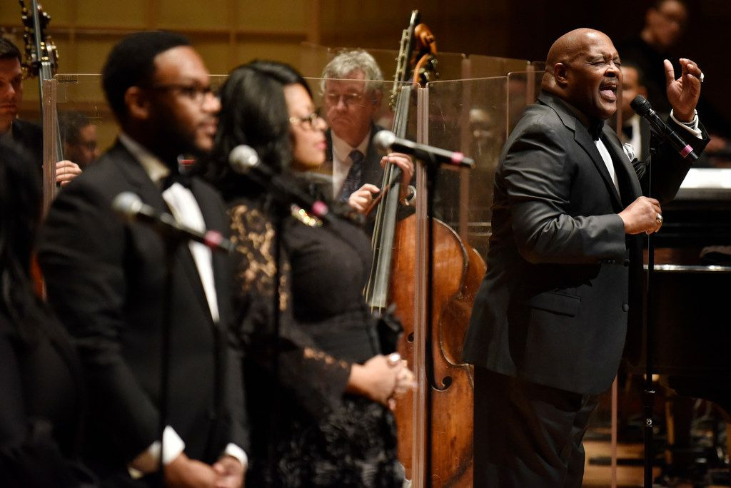 Marvin Winans, far-right, sings with the Dallas Symphony Orchestra during a performance of Gospel Goes Classical, Feb. 7, 2019 at the Morton H. Meyerson Symphony Center in Dallas.