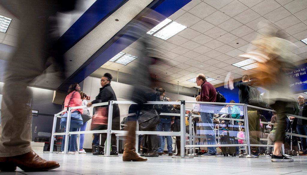 Travelers make their way thought DFW International Airport terminal C security on Friday, Dec. 21, 2018. Terminal C is the only terminal of the original four that has not been recently updated. As a result it is crowded and has the most dated layout.  (Shaban Athuman/The Dallas Morning News)