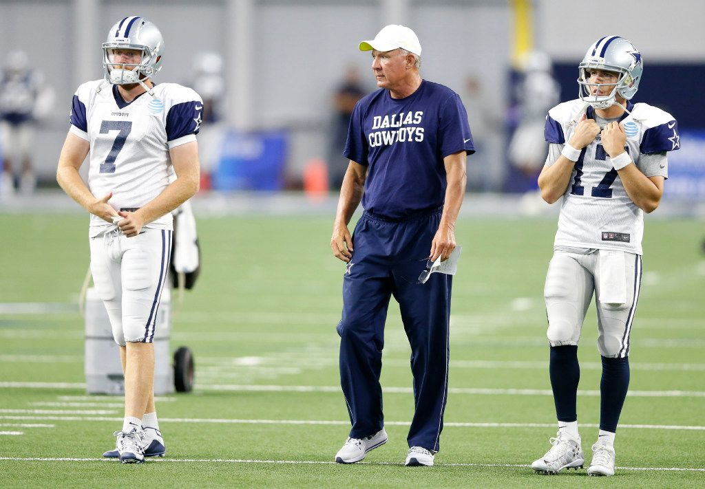 FILE - Cowboys quarterback Cooper Rush (7), quarterbacks coach Wade Wilson and quarterback Kellen Moore (17) watch as the first team goes through a play during training camp at The Star in Frisco on Tuesday, Aug. 22, 2017. (Vernon Bryant/The Dallas Morning News