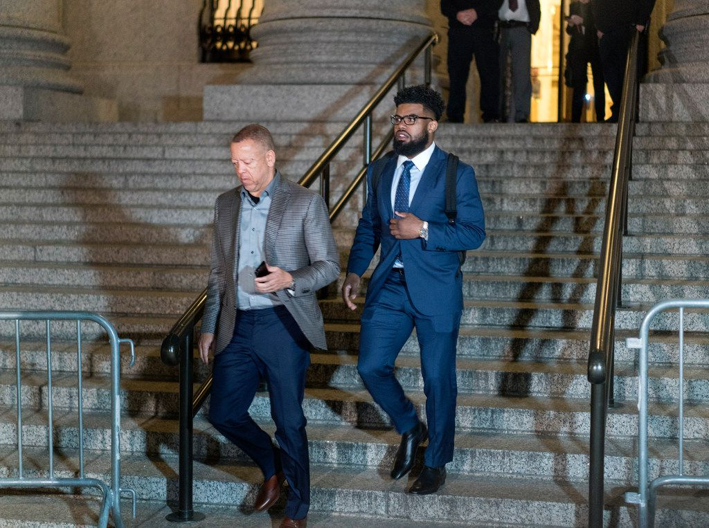 Dallas Cowboys star Ezekiel Elliott, right, exits federal court after a hearing Monday, Oct. 30, 2017 in New York. Elliott is seeking to have his six game suspension by the NFL postponed. (AP Photo/Craig Ruttle)