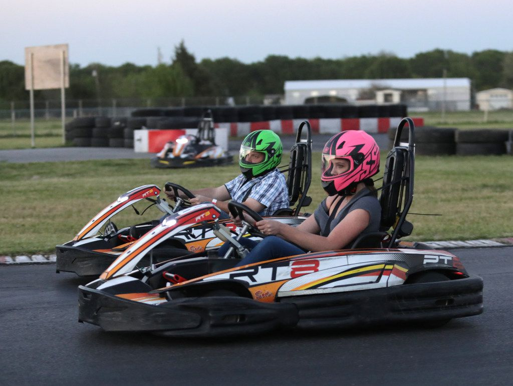 Guests race go-carts at Dallas Karting Complex in Caddo Mills, Texas.