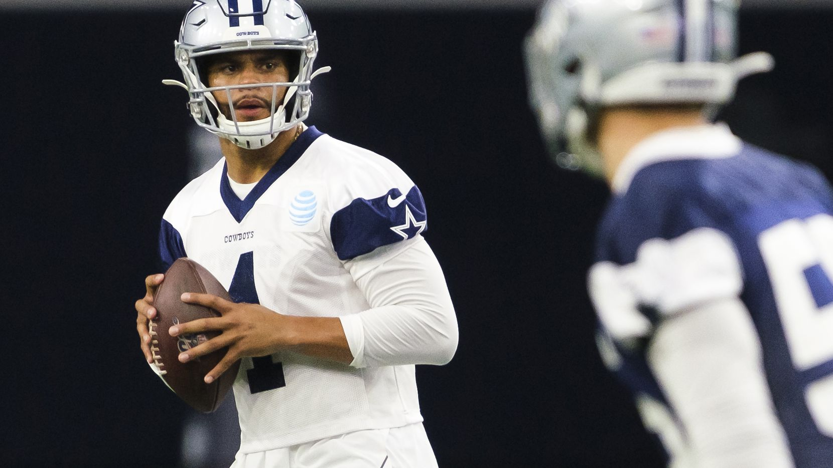 Dallas Cowboys quarterback Dak Prescott (4) looks to pass as linebacker Leighton Vander Esch (55) defends during a team OTA practice at The Star on Wednesday, June 5, 2019, in Frisco. (Smiley N. Pool/The Dallas Morning News)