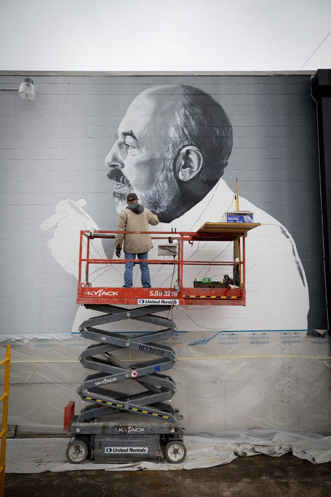 This mural of Neiman Marcus retail legend Stanley Marcus was commissioned by Shannon Wynne. Artist Brent Hale from Tyler took two weeks to paint the mural, which resembles a photograph of Marcus from the early 70s. The mural is at 2120 S. Ervay St. in The Cedars, near where Marcus lived as a child. The mural was photographed by Marcus' granddaughter, photographer and artist Allison V. Smith.