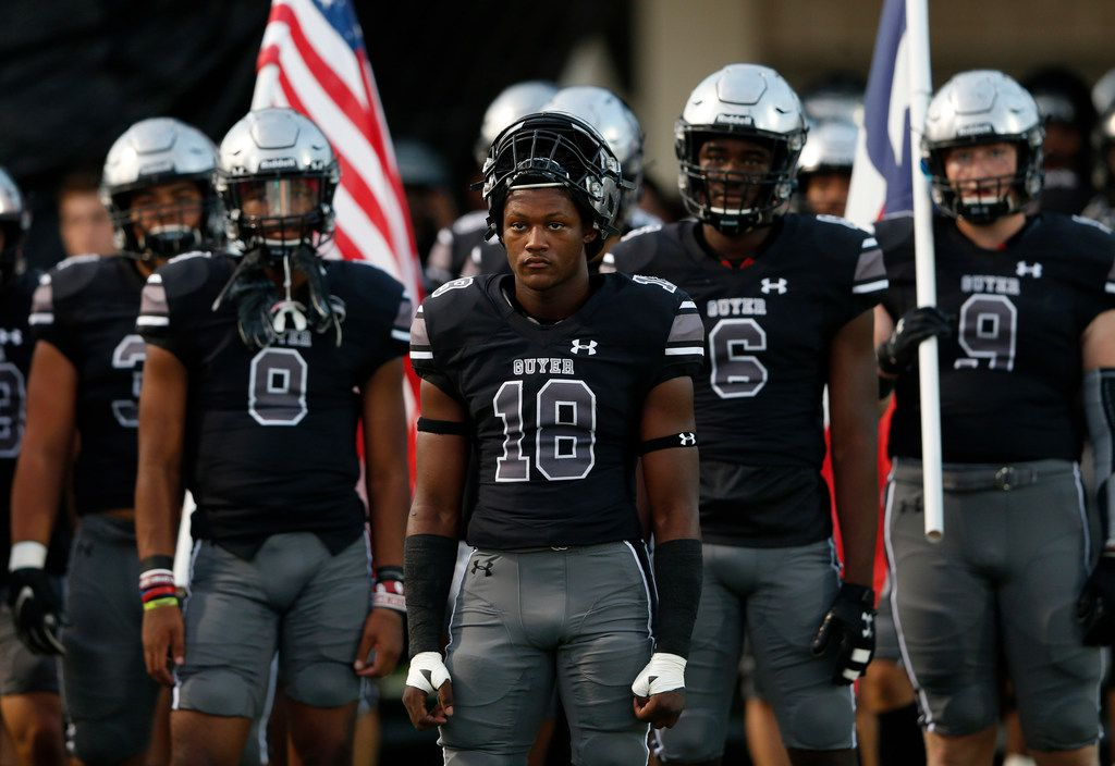 Denton Guyer's Jonathan Jones (18) and teammates prepare to take the field to play Southlake Carroll in the first half of play at C.H. Collins Complex in Denton, on Friday, October 4, 2019. (Vernon Bryant/The Dallas Morning News)