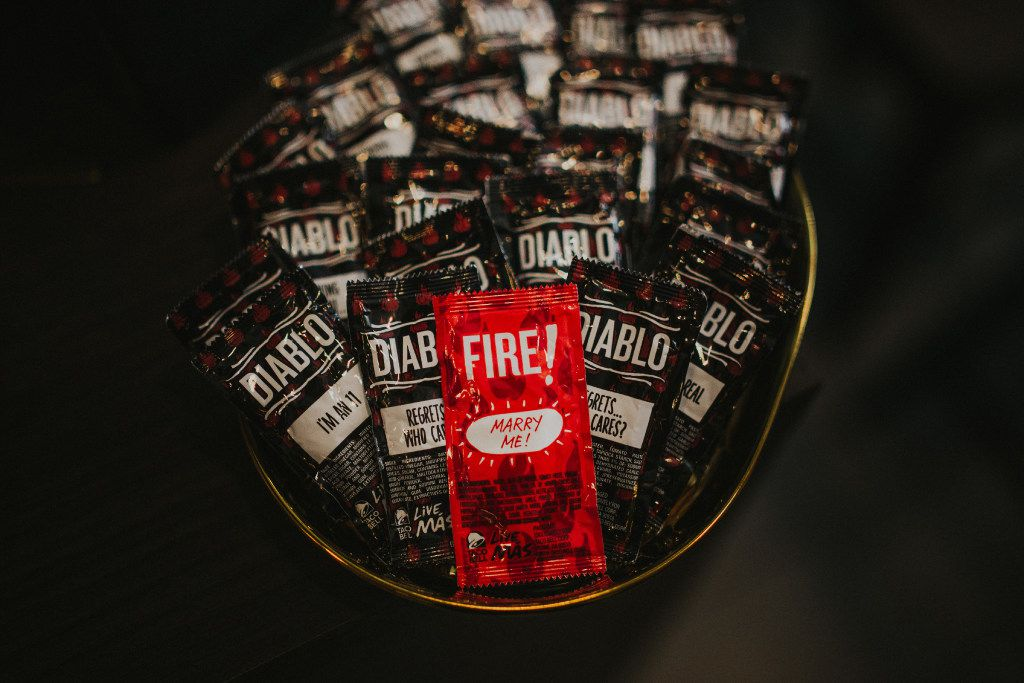 The Taco Bell Love and Tacos wedding includes custom merchandise for the bride and groom.