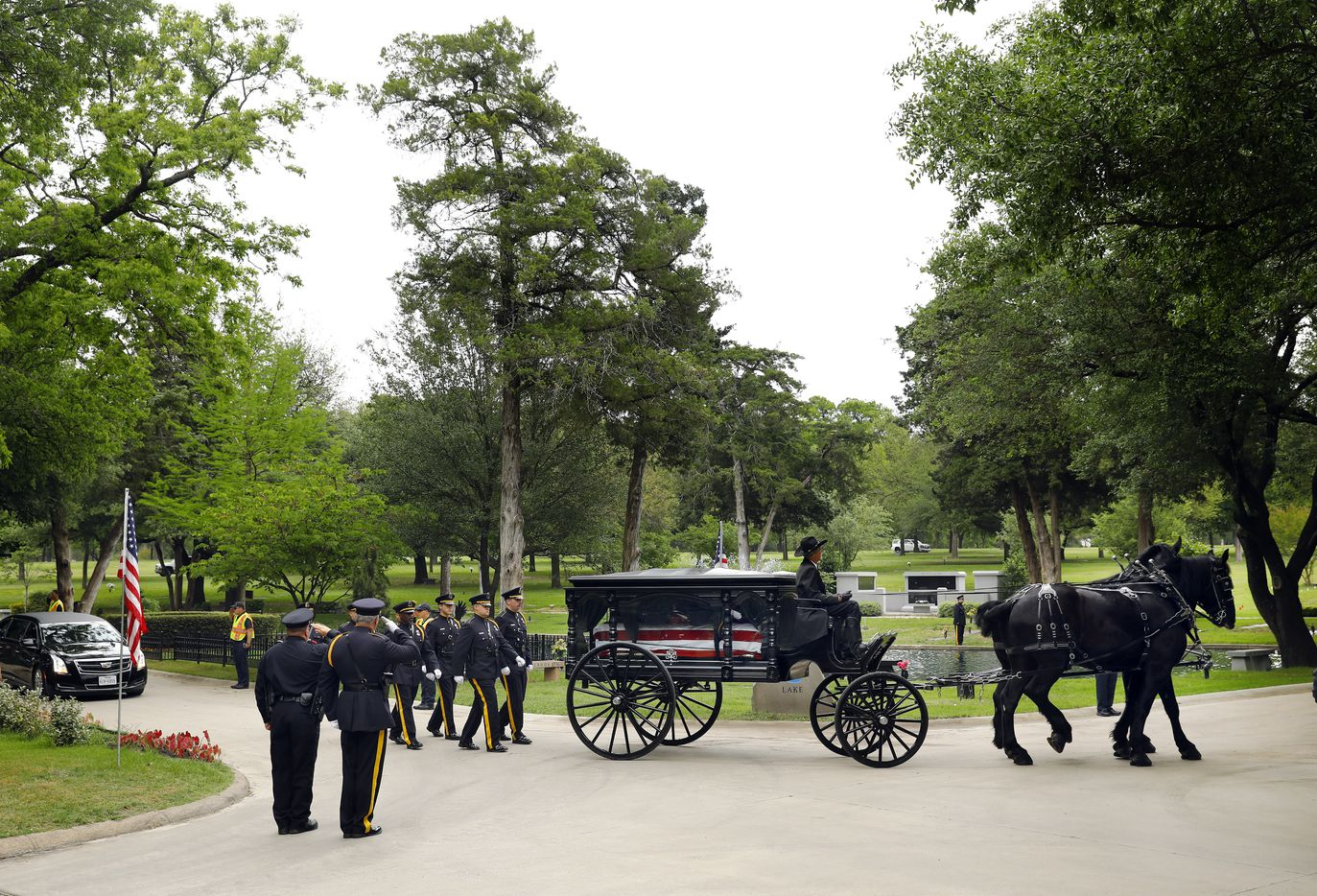 The Dallas Police Honor Guard escorts the horse-drawn carriage carrying slain Dallas police officer Rogelio Santander, Jr. to his resting place in the Garden of Honor.