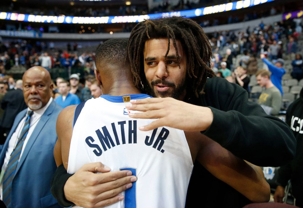 Dallas Mavericks guard Dennis Smith Jr. (1) and musical artist J. Cole meet up after the game at American Airlines Center in Dallas on Wednesday, December 20, 2017. Dallas Mavericks defeated the Detroit Pistons 110-93. (Vernon Bryant/The Dallas Morning News)