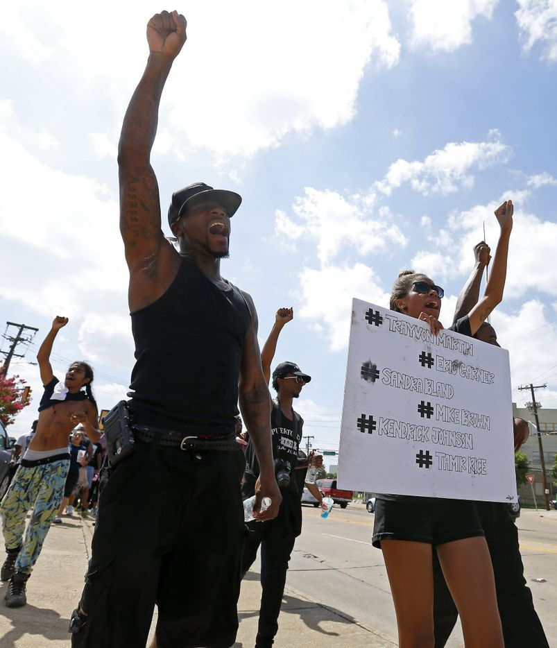 People protest at a Black Lives Matter rally on Park Lane in Dallas, Sunday, July 10, 2016. (Jae S. Lee/The Dallas Morning News)