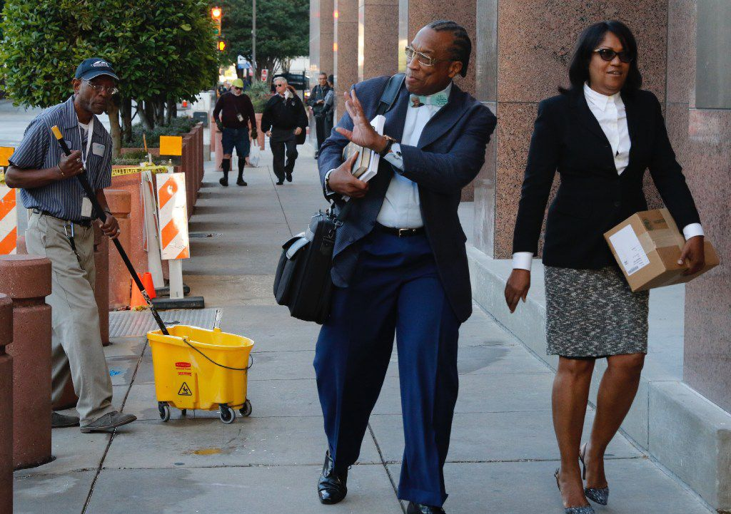 Dallas County Commissioner John Wiley Price, left, and co-defendant Dapheny Fain, Price's chief of staff, walk into the Earle Cabell Federal Building and Courthouse on Monday, The federal jury deciding the bribery and tax evasion case against Price entered its fourth day of deliberations Monday. (David Woo/The Dallas Morning News)