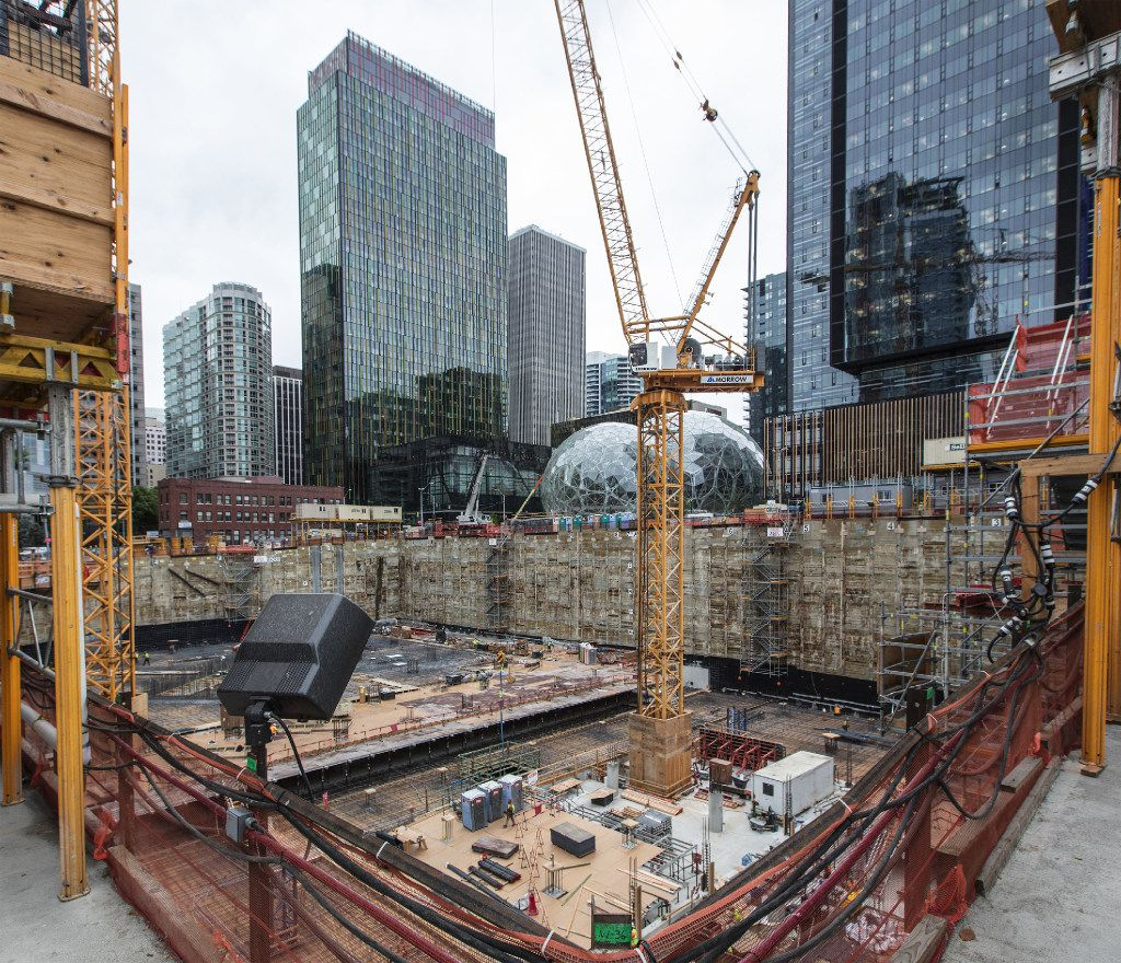 This angle looks across the foundation of another Amazon building being built near Amazon's Doppler building at left, and its Spheres and Day 1 building at right, in downtown Seattle, Wash. (Steve Ringman/Seattle Times/TNS)