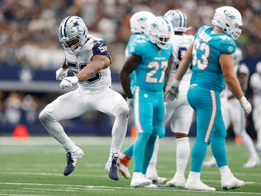 Dallas Cowboys defensive end Robert Quinn (58) celebrates after sacking Miami Dolphins quarterback Josh Rosen (3) during the second half of play at AT&T Stadium in Arlington, Texas on Sunday, September 22, 2019. The Dallas Cowboys defeated the Miami Dolphins 31-6.