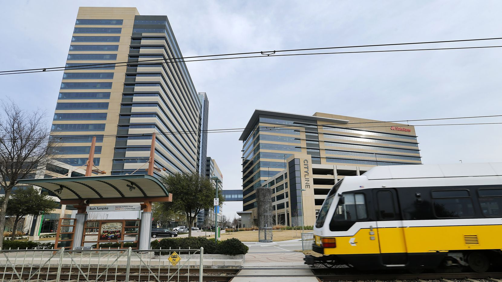 A DART train pulls into the Bush Turnpike station at the State Farm-anchored CityLine development in Richardson. (Tom Fox/The Dallas Morning News)