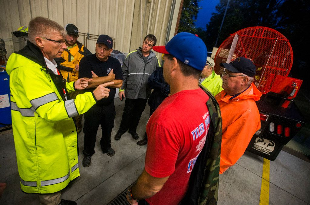 Fire Chief Jeff McNeal (left) directs volunteers at Lumberton Central Fire Station as Hurricane Harvey made landfall for a second time on Tuesday, Aug. 29, 2017 at Central Fire Station in Lumberton.