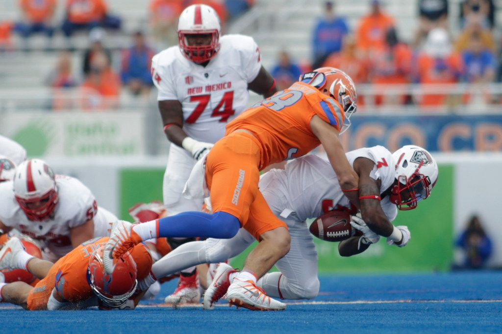 Boise State linebacker Leighton Vander Esch causes a fumble by New Mexico running back Richard McQuarley (3) during the first half of an NCAA college football game in Boise, Idaho, Thursday, Sept. 14, 2017. (AP Photo/Otto Kitsinger) ORG XMIT: IDOK103
