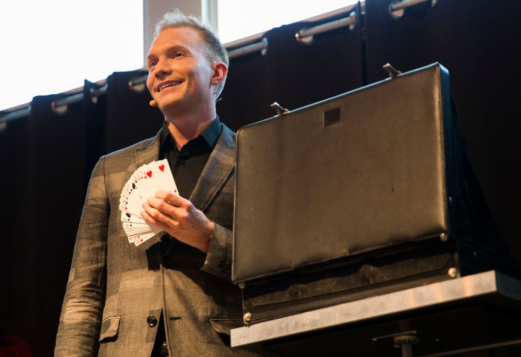 Magician Trigg Watson performs at Checkered Past Winery on Saturday, July 14, 2018 at Lone Star Park in Grand Prairie. (Ashley Landis/The Dallas Morning News)